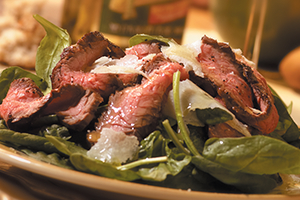 Flank Steak Carpaccio-Style with Spinach and Shaved Parmesan