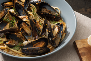 Mussels in White Wine and Sun-Dried Tomato Broth